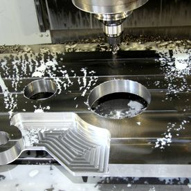 machine cutting metal with precision